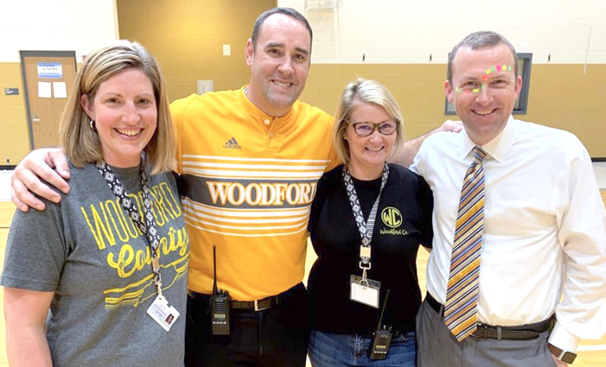 "DEPARTING PRINCIPAL Tracy Bruno, at right wearing face paint, is pictured with his administrative team at last year's Woodford County Middle School back-to-school pep rally. From left are Administrative Dean Susan Tracy, Assistant Principal Scott Hundley, now head principal at Northside Elementary School, and Assistant Principal Liz Kirk, who will serve as interim principal at WCMS during the 2020-21 school year. ""We called ourselves the dream team,"" said Kirk. ""We all had strengths that played off of each other."" (Photo submitted)"