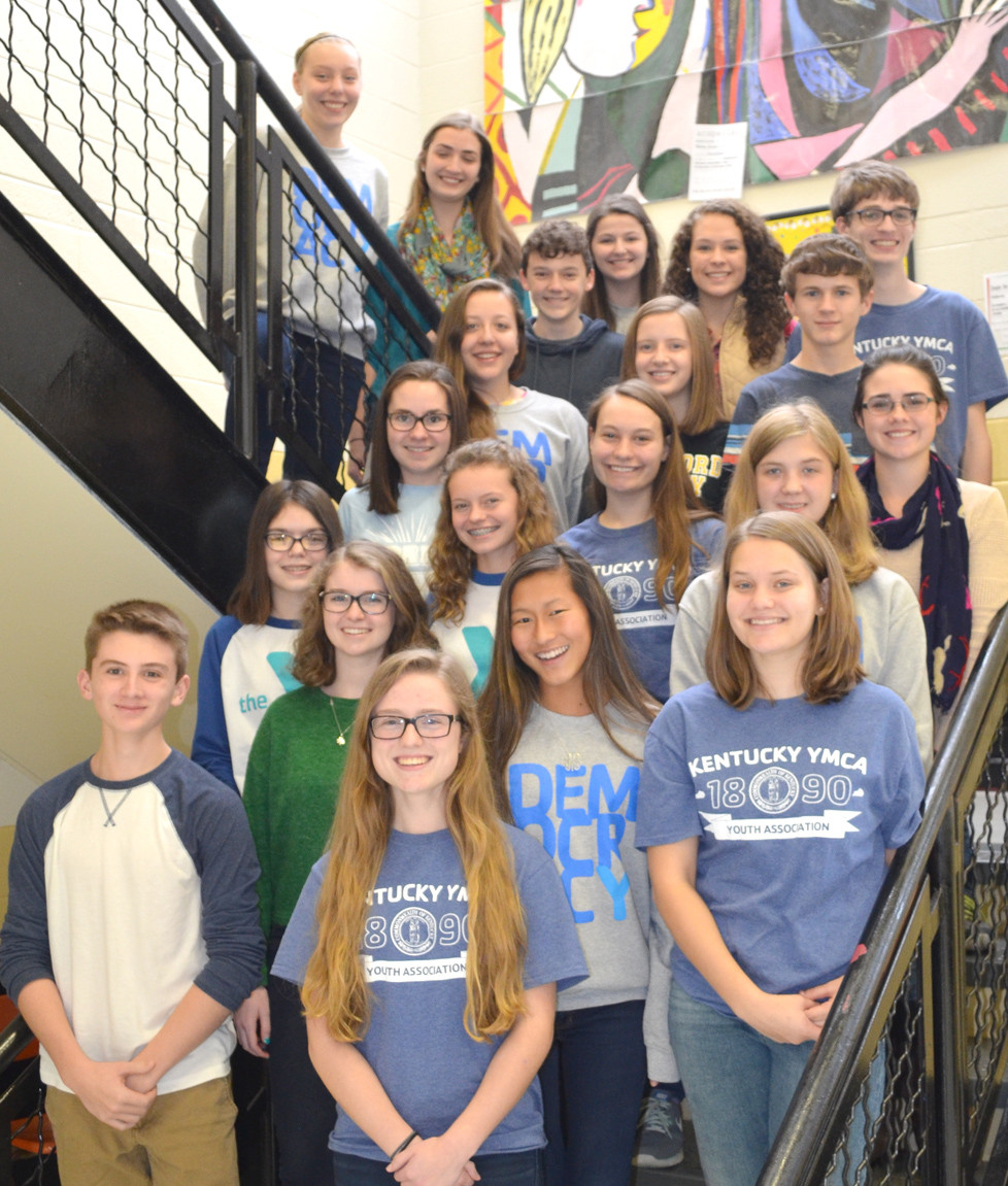 A DELEGATION OF STUDENTS represented Woodford County High School at the Kentucky Youth Assembly in Louisville recently. Pictured are student-delegates, front, from left, Tony Brock, Abigail Mortell, Tessa Brengelman, Regan Martin and Reagan Lynn; second row, Sarah Potts, Christine Slover and Erin Lawson; third row, Sophie Edelen, Abigail Renner and Emily Melcher; fourth row, Ginny Hallman, Kristen Taylor and Carter Smith; fifth row, Parker Raybourne, Emily DeBold, Caleigh Evans and Logan Curtis; with Adie Preston and Abigail Cheek on stairs. Not pictured are Allison Miller, Rachel Vascessenno, Carson Mullins, Gloria Mullins, Josh Finley, J.B. Hudson, Zia Luchtefeld and Turner Reynolds. (Photo by Bob Vlach)