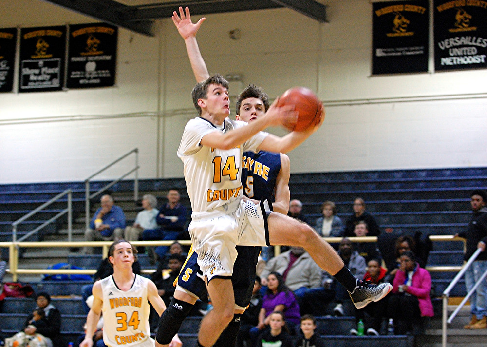 Chandler Stewart goes for a layup during the Woodford County High School boys' basketball game against Sayre at home in The Hive on Tuesday, Jan. 12. Stewart finished the game with 11 points to help the Yellow Jackets win 65-47 and bring their record to 9-9 heading into an important district game at Franklin County on Friday. (Photo by Rick Capone)