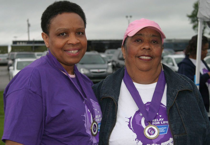 FRIENDS FOR LIFE: Rita Kirtley and Eveleen Morton grew up across Dunroven Drive from each other. Each has battled breast cancer, and took turns taking the other to the doctor they share. The friends participated in the American Cancer Society Relay for Life on Friday, May 20. (Photo by John McGary)
