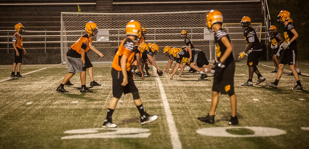 THE WOODFORD COUNTY football team lines up at the 20-yard line at practice July 18. (Photo by Bill Caine)