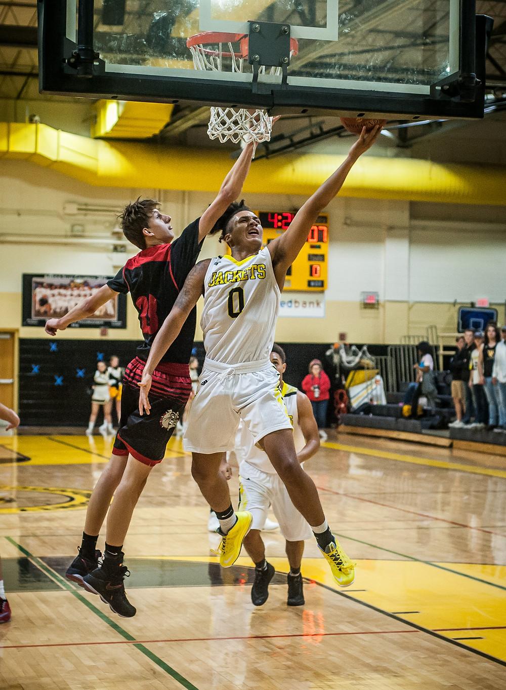 SENIOR NICK SMITH attempts a layup in the Jackets win over Dunbar on Monday Nov. 27. (Photo by Bill Caine)