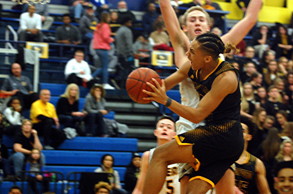 NICHOLAS SMITH goes for a layup during the Woodford County High School boys' basketball game against district rival, Franklin County, on Friday, Jan. 13, in Frankfort. While it was a close game all the way to the end, the Flyers got the win, 48-45. (Photo by Rick Capone)