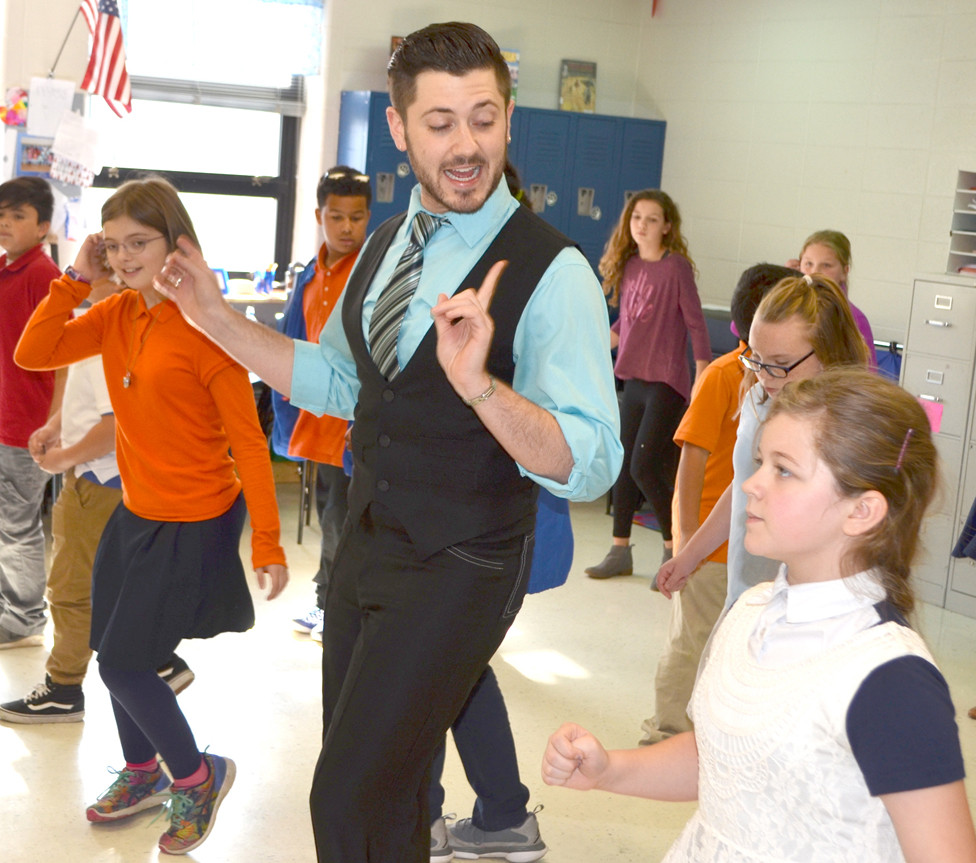 DUNCAN KING, a former student at Simmons Elementary, returned for Arts Day on Nov. 21. The 2010 Woodford County High School graduate makes his living as a ballroom dancer and instructor. He returned to Versailles last March after spending two years in Los Angeles. (Photo by Bob Vlach)