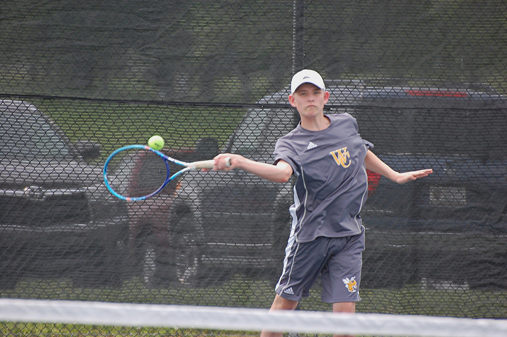 EVAN BENTLEY, shown competing at the recent WCI tennis tournament, has held down the No. 1 singles position on the Woodford County High School boys' team all season long and has had good results. (Photos by Rick Capone)
