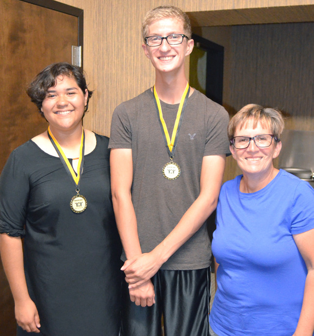 XARLEY CHAVEZ, left, and Bryan Caldwell participated in the Governor's School for the Arts this summer along with Kevin Lausche, not pictured. Woodford County Board of Education member Karen Brock is also pictured. (Photo by Bob Vlach)