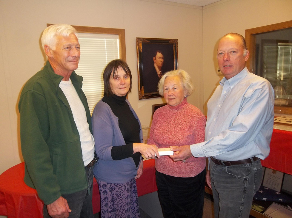 THE JACK JOUETT HOUSE received a donation of a miniature portrait painted by Matthew Harris Jouett. The donation was made by Patrick and Evelyn A. McGill, left. Missie Wood and Steve Menefee accept the gift on behalf of the Jack Jouett House. (Photo submitted)