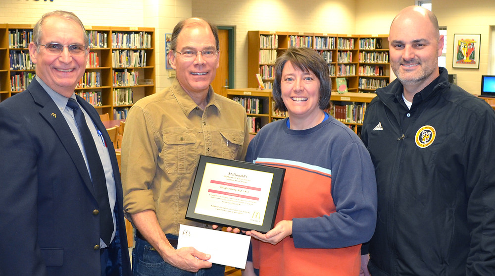 JOE GRAVISS presented a $1,000 Balanced, Active Lifestyles grant to Melody Hamilton, a physical education teacher at Woodford County High School. Hamilton applied for the grant to purchase mannequins for CPR training at WCHS. Also pictured are WCHS Principal Rob Akers, far right, and Bob Waitkus, of Graviss McDonald's Restaurants, far left. (Photo by Bob Vlach)