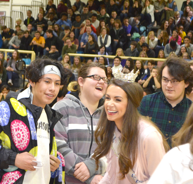 MISS KENTUCKY Molly Matney and students had a good time during Woodford County High School's annual turkey calling contest at its food drive assembly on Nov. 21. From left are Victor Lopez, Cheyenne Combs, Matney and Andrew Padgett. (Photo by Bob Vlach)