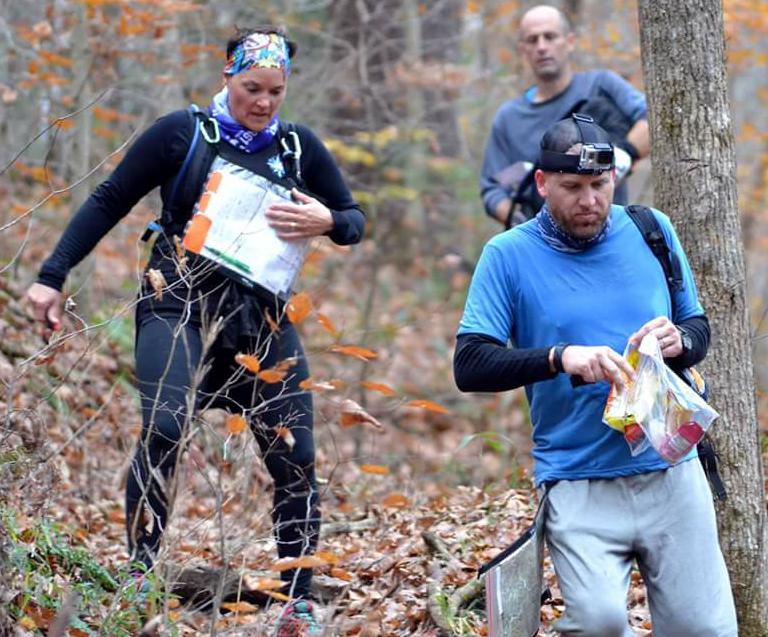 CUTLINE: SOMETIMES, DOWN THE side of a mountain is the quickest way to the next check point for adventure racers. From left are Tefany Bleuel, Jeremy Reynolds and Jason McAllister (holding bags of snacks). (Photo submitted)