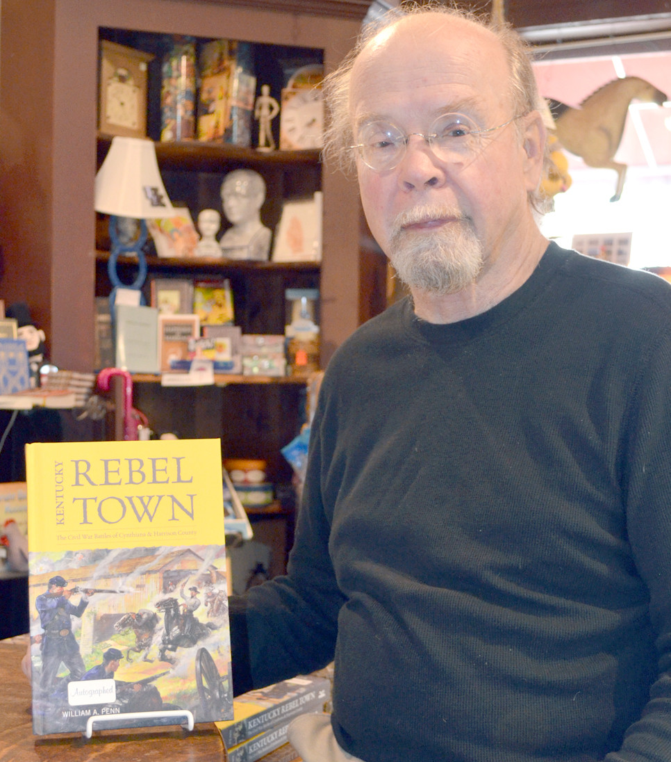 BILL PENN writes about his native Cynthiana and Harrison County during the Civil War in his recently published book, Kentucky Rebel Town. Penn and his wife, Leslie, own the Historic Midway Museum Store in downtown Midway. (Photo by Bob Vlach)