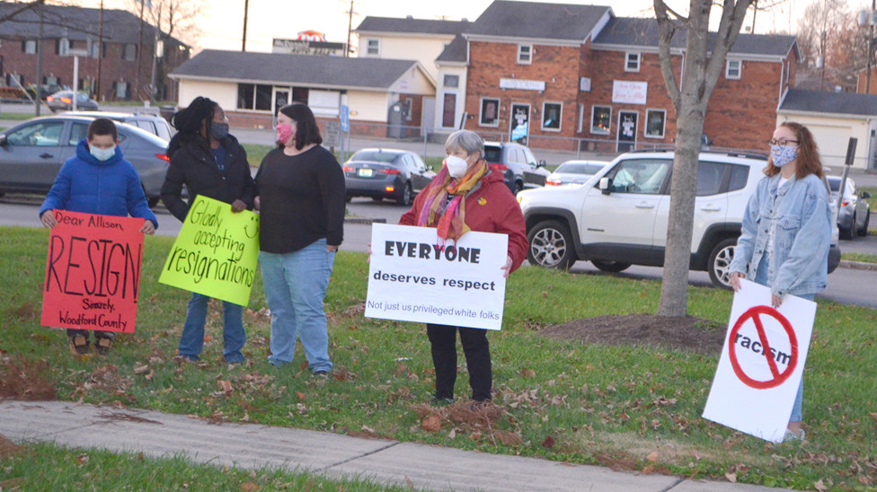 PARENTS, STUDENTS AND OTHERS participated in a protest outside Woodford County High School prior to Monday's Woodford County Board of Education meeting. They held up signs that condemned board member Allison Richardson for her recent Facebook posts and urged her to resign. (Photo by Bob Vlach)