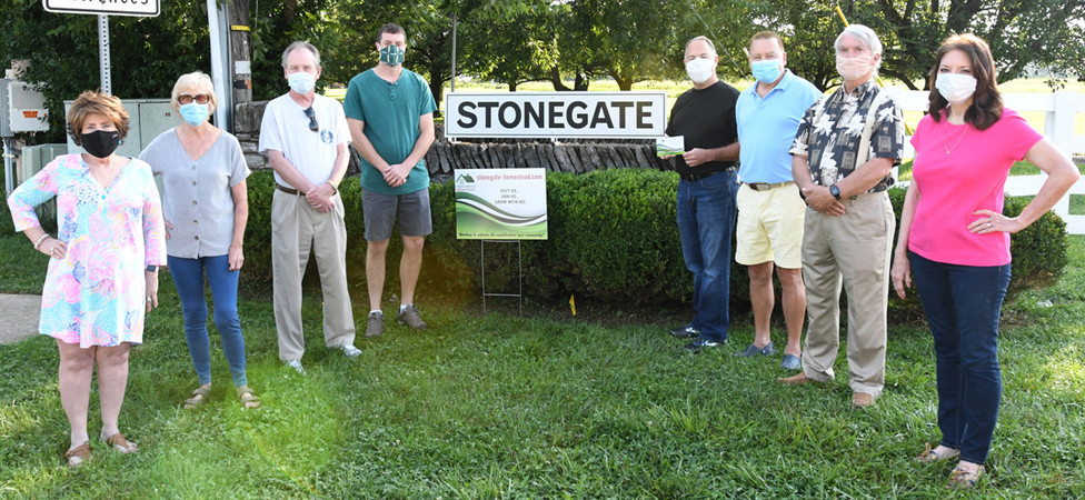 STONEGATE-HOMESTEAD NEIGHBORHOOD Association board members are pictured with a recently-erected sign at the entrance of the Stonegate subdivision. A grant awarded by the Council of Neighborhood Associations helped pay for the sign. From left are board members Linda Roscoe, Sheila Hollin, Steve Davis, Jeff Richards, Brad Eldridge, Lonnie Leland, Jerry Mueller and Connie Davis. (Photo submitted)