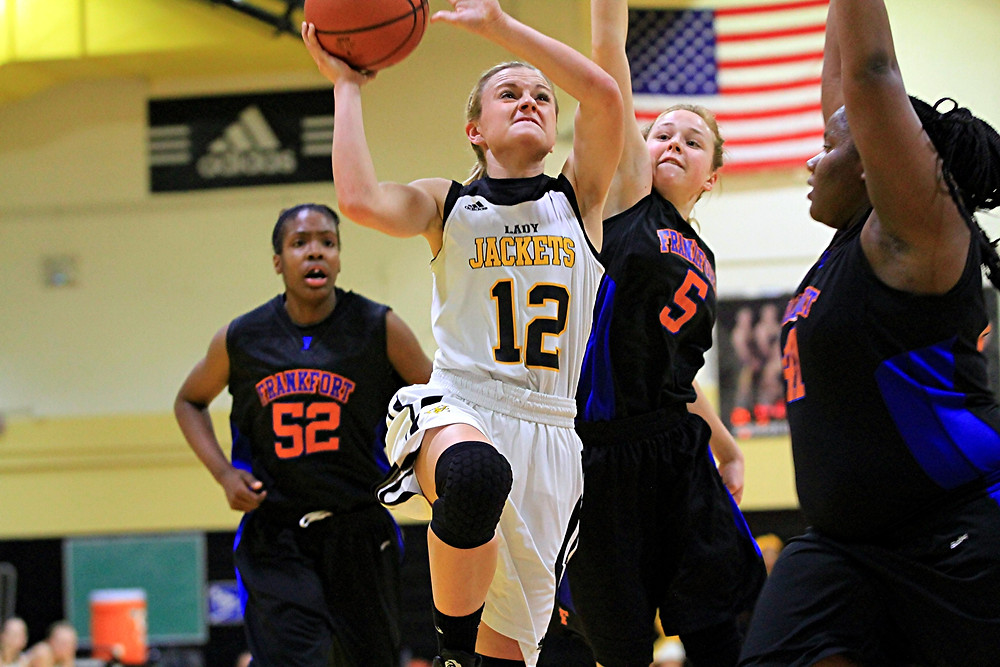 CAITLIN FERGUSON has been one of the key players for the Woodford County High School girls' basketball team so far this season. To date, the senior is third in the state in three-point shooting and in the top 20 in scoring. (Photo by Steve Blake/multiexposures.com)