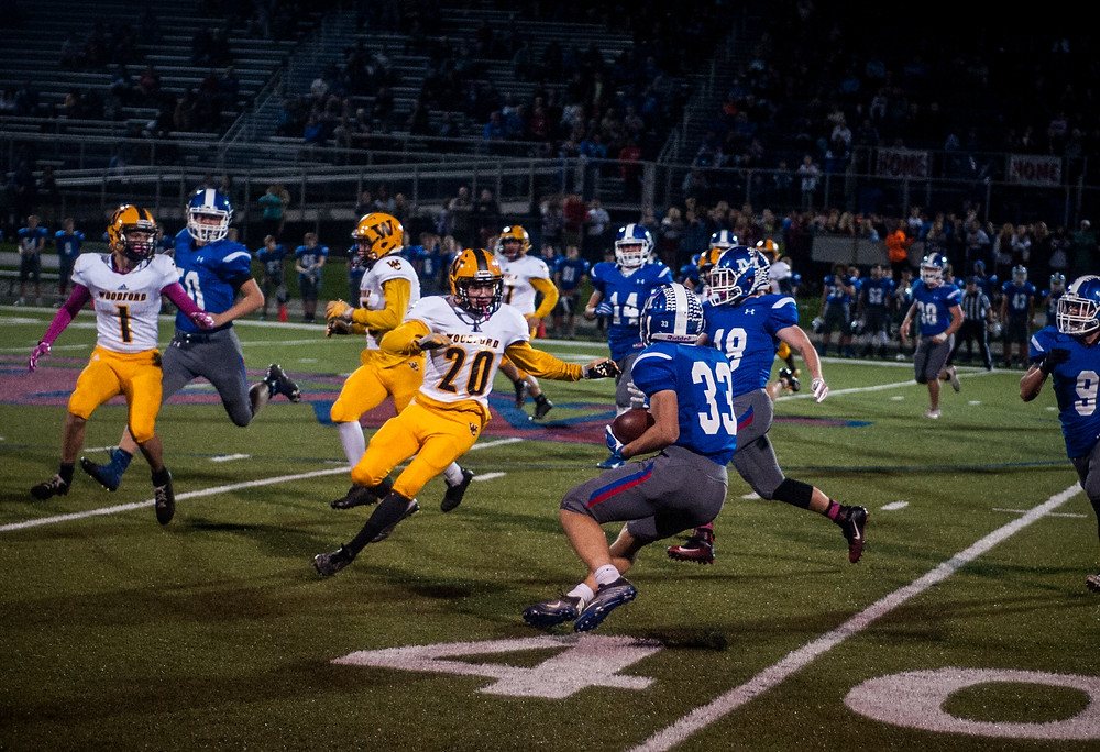 SOPHOMORE CHARLIE ELLIOTT closes in on a Montgomery County ball carrier in the first half against Montgomery County, Friday, Oct. 20.  (Photo by Bill Caine)