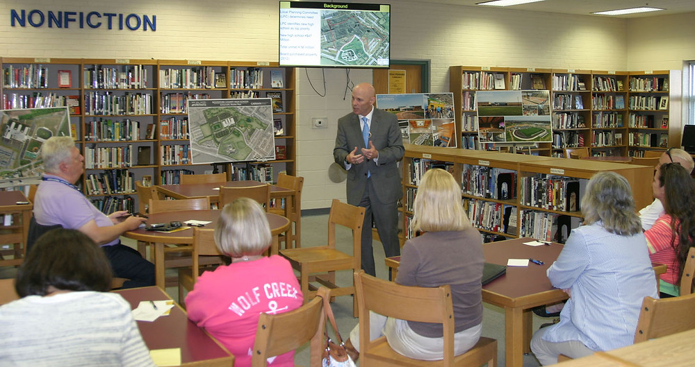 """WOODFORD COUNTY SCHOOLS SUPERINTENDENT Scott Hawkins pitched a new high school and a """"facilities"""" property tax hike to pay for it. The presentation took place in the present Woodford County High School library Thursday, Aug. 31. Twenty or so people attended and Hawkins answered questions posed from several, among them Magistrate Mary Ann Gill (Dist. 6), bottom left. (Photo by John McGary)"""