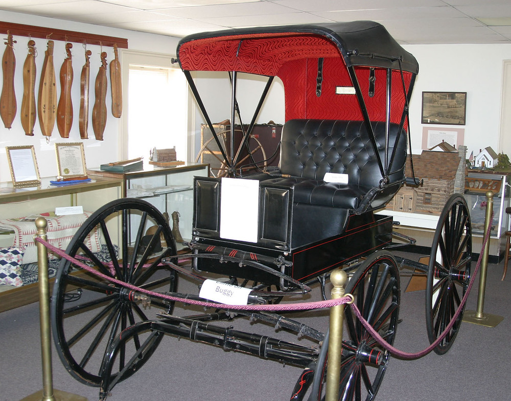 THIS BUGGY is the largest display on the second floor of the Woodford County Historical Society, which purchased its present headquarters in 1969 for $10,000, then began renovating it. (Photo by John McGary)