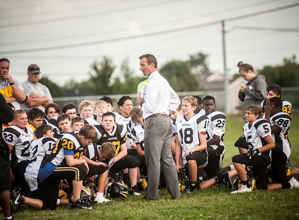 NEW WCMS FOOTBALL COACH RYAN ASHER greets the middle school team for the first time on Aug. 30. Asher has taken over as interim coach for the remainder of the season. (Photo by Bill Caine)