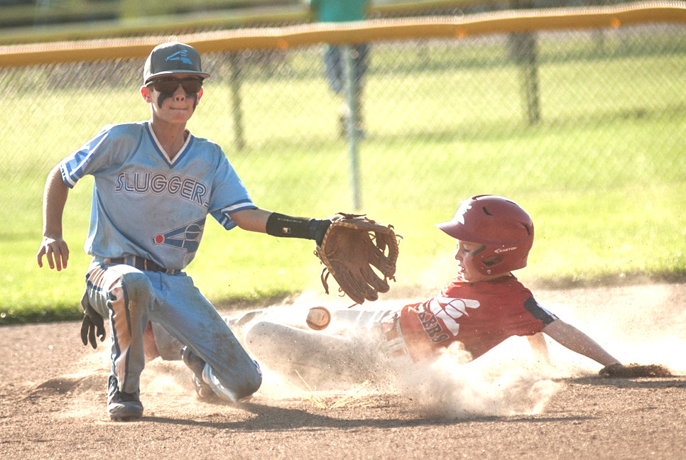 BRADFORD LACEFIELD slides into second base at the 10th annual Woodford Summer Slam. (Photo by Bill Caine Photography, www.billcaine.com)