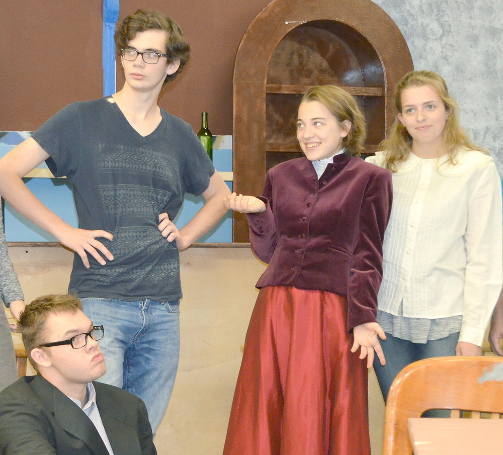 """PICASSO AT THE LAPINE AGILE,"" a stage comedy written by well-known actor and comedian Steve Martin, comes to the Woodford County High School stage for three performances beginning tonight. Pictured, from left, during a recent rehearsal, are Nate Whitlock, Caleb Adkins, Eliza Bradshaw and Victoria Lobsiger. (Photo by Bob Vlach)"