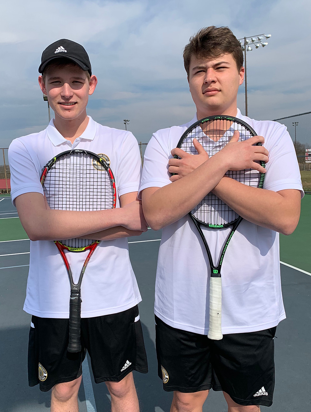 WCHS TENNIS PLAYERS Evan Bentley and Mason McIntyre reached the round of 16 in the KHSAA State Tournament. Bentley, left, is a sophomore, while McIntyre, right, is a graduating senior. The pair said their win in the round of 32 was undoubtedly their best performance of the season. (Photo submitted)