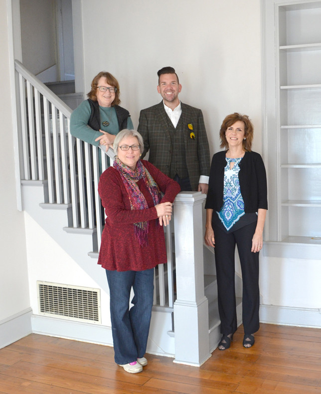 VERSAILLES ART SPACE Steering Committee members, from left, are Mary Nehring, Julie Buchanan, Brad Fister and Laura Dake (chair), standing in the Court Street building formerly occupied by the offices of Versailles United Methodist Church. Not pictured, but also on the committee exploring a vision for an art space in downtown Versailles, is Karen Isberg. (Photo by Bob Vlach)