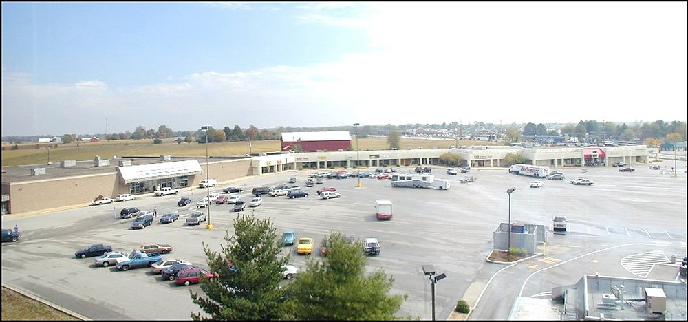 """THE SITE of the old Versailles Center on the U.S. 60 Bypass at Lexington Road will be the site for a Holiday Inn Express. This photo was taken from the fifth floor of the United Bank building in September 1999, shortly after the property was acquired by Rubloff Development Group. After a decade and a half of neglect, the buildings were declared a """"blighted"""" property and razed by the City of Versailles in 2014, the cost of which was recouped with interest. (File photo by Stephen Peterson)"""