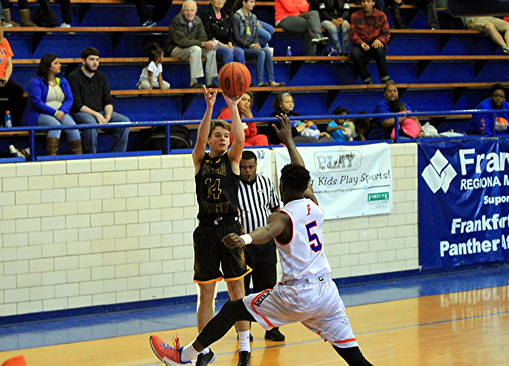 CHANDLER STEWART put on a dominating performance in Woodford County High School boys' basketball team's 77-56 win at Frankfort on Saturday, Jan. 30. The sophomore scored 32 points and pulled down five rebounds to help the Yellow Jackets lock up first place in the 41st District. (Photo by Steve Blake/multiexposures.com)