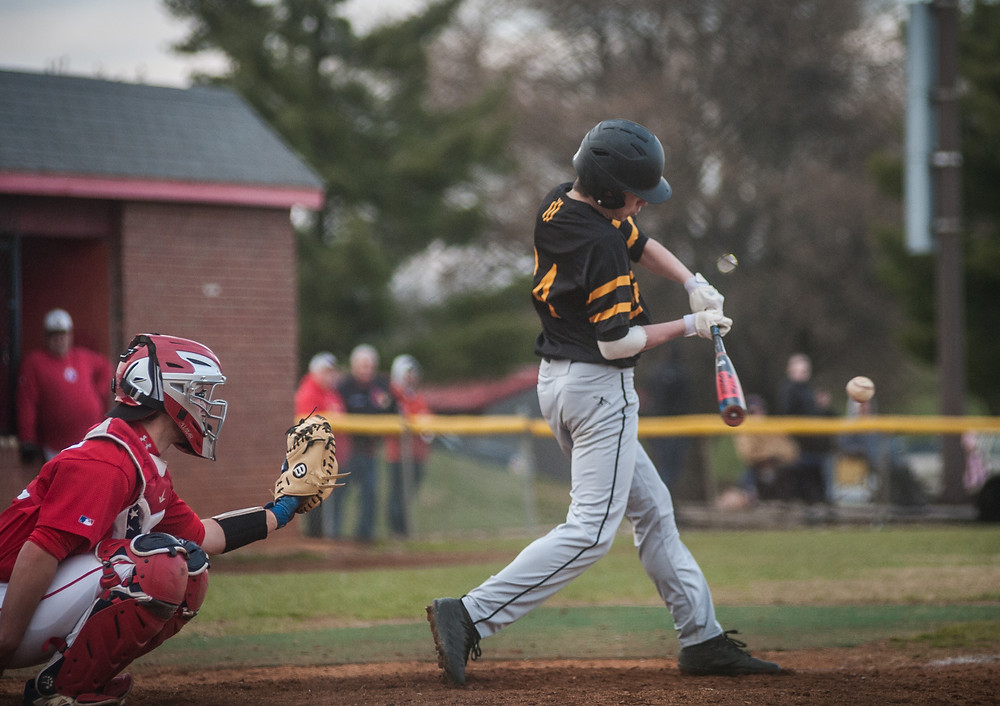 WCHS JUNIOR LEO GUADAGNI swings at a pitch in the first inning of the Bat Jackets' loss to the Scott County Cardinals on Friday, March 23.  He was 0-2 with a walk in the game. (Photo by Bill Caine)