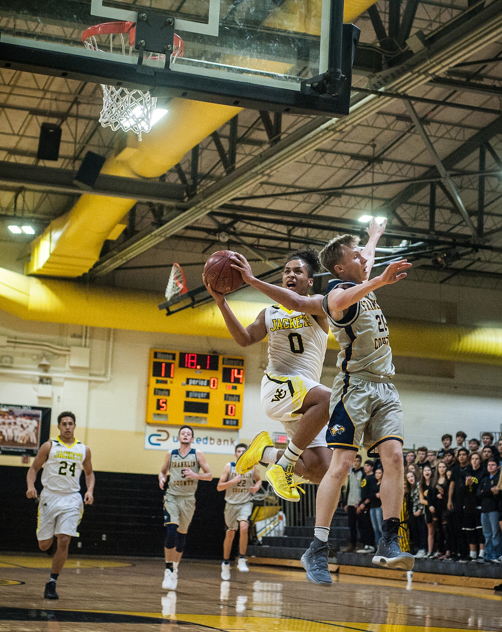 ABBIE HUDSON attempts a shot over a Lady Flyer defender in the second half of the Lady Jackets' loss on Friday, Dec. 8. (Photo by Bill Caine)
