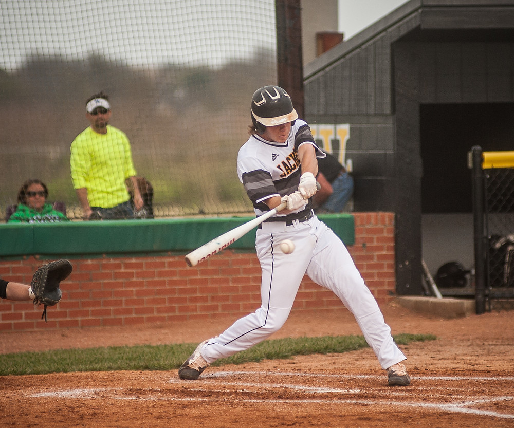 WCHS JUNIOR BEN BROWNING connects with a ball in the first inning of the Jackets' 5-1 win over Western Hills on Wednesday, April 18. (Photo by Bill Caine)