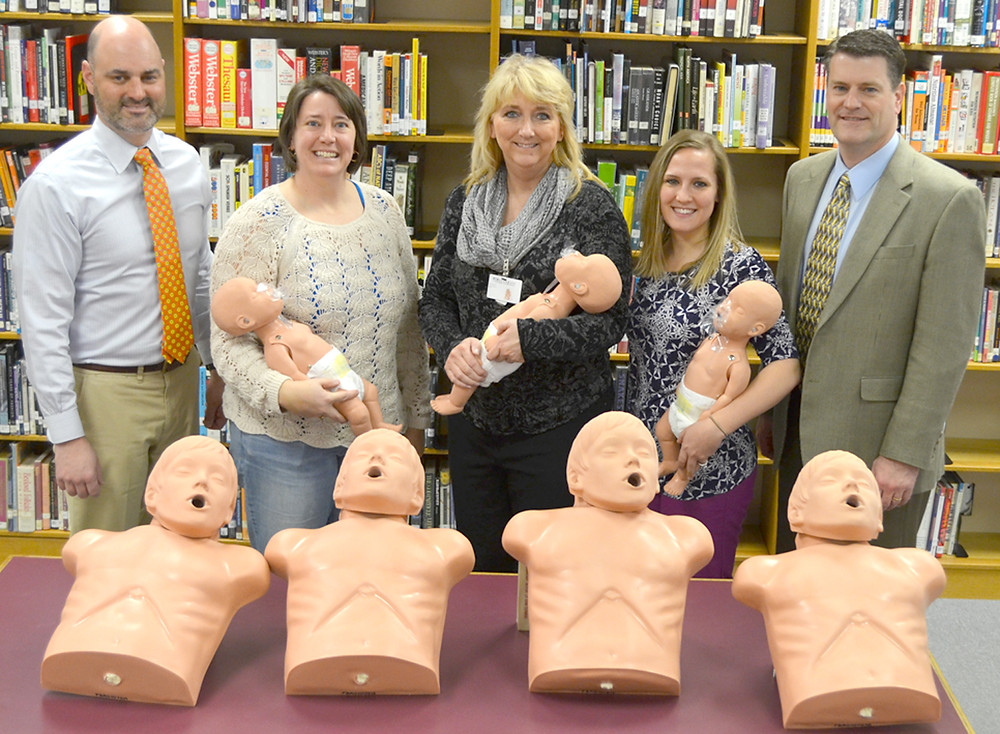 BLUEGRASS COMMUNITY HOSPITAL donated eight CPR mannequins to Woodford County High School on Tuesday afternoon. From left are WCHS Principal Rob Akers, PE teacher Melody Hamilton; Kathy Russell, chief nursing officer at Bluegrass Community Hospital; Bridget Foster, the hospital's director of marketing; and hospital CEO Tommy Haggard. (Photo by Bob Vlach)