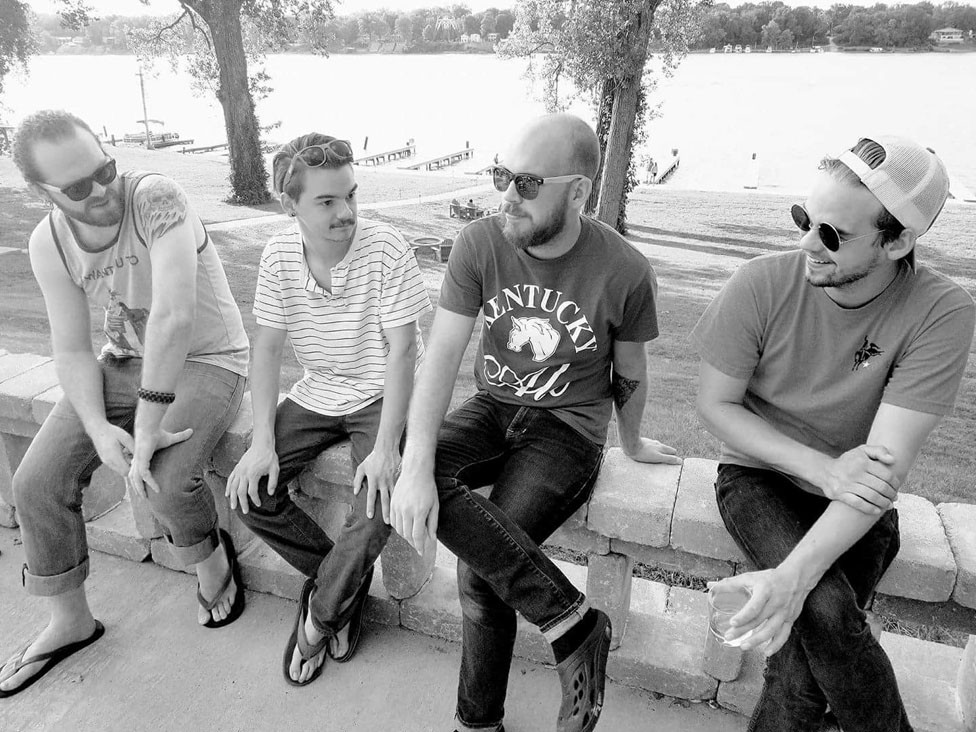 TRIPPIN' ROOTS, all of whom hail from Versailles, will play at Addie's Saturday during the Unique Taste of Woodford. From left are, Zac Day, Aaron White, Evan Curran and Andrew White. (Photo submitted)