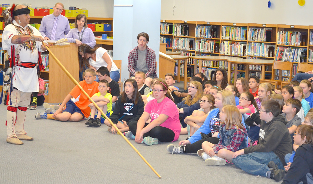 SONNY LEDFORD demonstrated how a blowgun works during a program on Cherokee culture for fifth-graders at Southside Elementary School on April 15. Ledford told the students that Cherokees only used their blowguns to hunt squirrels and other small game. (Photo by Bob Vlach)