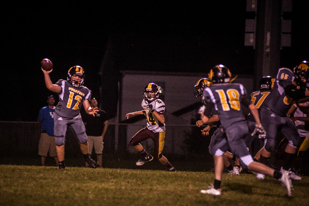 STEPHEN REED attempts a pass in the Sept. 21 game at home against Elkhorn. (Photo by Bill Caine)