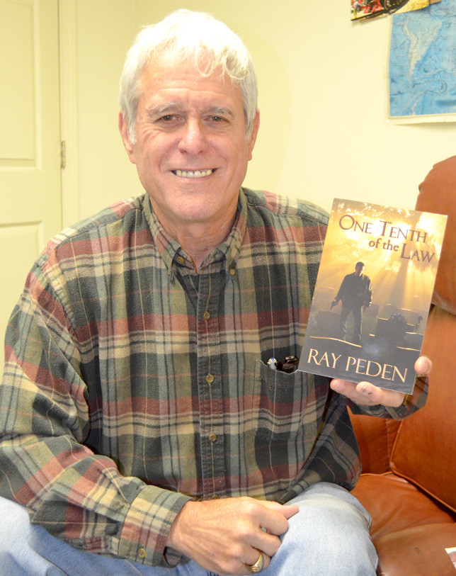 RAY PEDEN, who lived in Versailles during the 1980s, recently self-published his debut novel, One Tenth of the Law. After making the decision to pursue a writing career when he retired, Peden says it took years before he could tell a good story. (Photo by Bob Vlach)