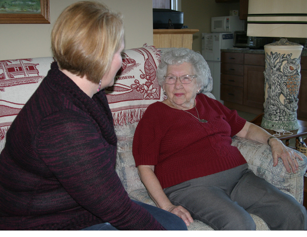 """JULIA MAUPIN, right, was one of the first residents of The Homeplace at Midway. The 93-year-old lives in the center's assisted living cottage in a spacious apartment, and said The Homeplace """"was just what I needed."""" (Photo by John McGary)"""