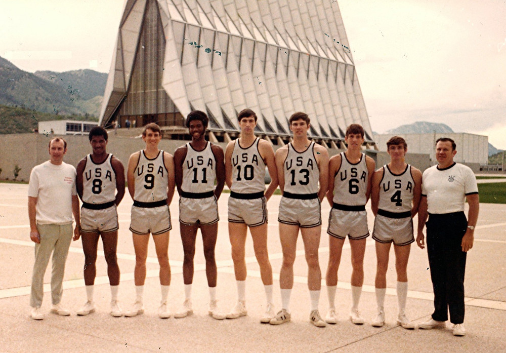 GENE KIRK, No. 9, won a gold medal at the 1972 Intercontinental Cup, which was played in Sao Paulo, Brazil, against teams from Russia, Brazil and Poland. He also tried out for the 1972 USA Olympic team. At the trials, players were broken down into teams and competed for a spot on the USA team. In this photo, standing in front of the chapel at the Air Force Academy, are members of Kirk's Olympic Trial team. They are, from left, Joe Cipriano (head coach), Tom Henderson, Gene Kirk, Dwight Jones, Tom McMillen, Cliff Parsons, Doug Collins, Bob Cremins and Tynes Hillebrand (assistant coach). In the end, Kirk didn't make the squad, but a few of his teammates did. (Photo courtesy of Gene Kirk)