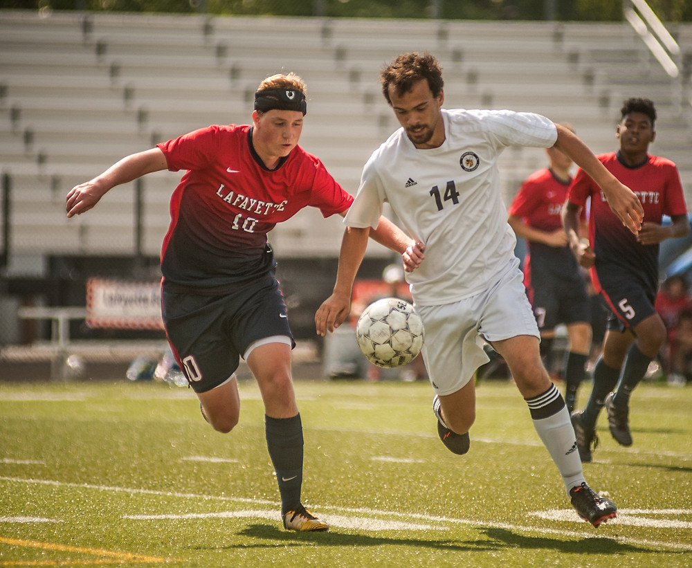 MARCUS WATSON goes on the attack for the Jackets at the Lexington Soccer Showcase. (Photo by Bill Caine)