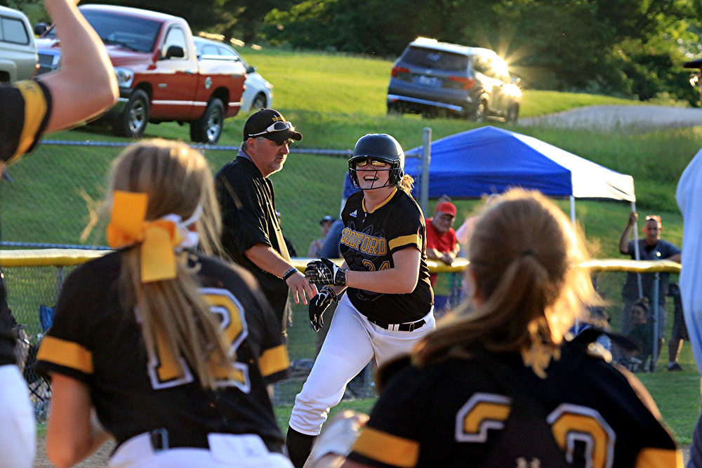 HER SMILE SAID IT ALL. Delaney Enlow's smile was a mile wide as she rounded third base and headed for home where her teammates waited to congratulate her for her home run in the sixth inning of the 11th Region tournament championship game at Lakeview Park in Frankfort on Wednesday, May 31, that gave the Lady Jackets a 1-0 lead over Scott County. The score held up to give Woodford the win and its first region championship since 2006. (Photo by Steve Blake/multiexposures.com)