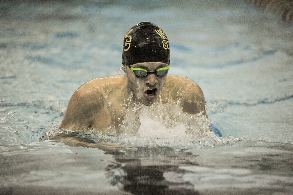 CLAY LEWIS competes in the 200 meter individual medley in Woodford County High School's swim meet on Wednesday, Nov. 15 at Falling Springs. (Photo by Bill Caine)