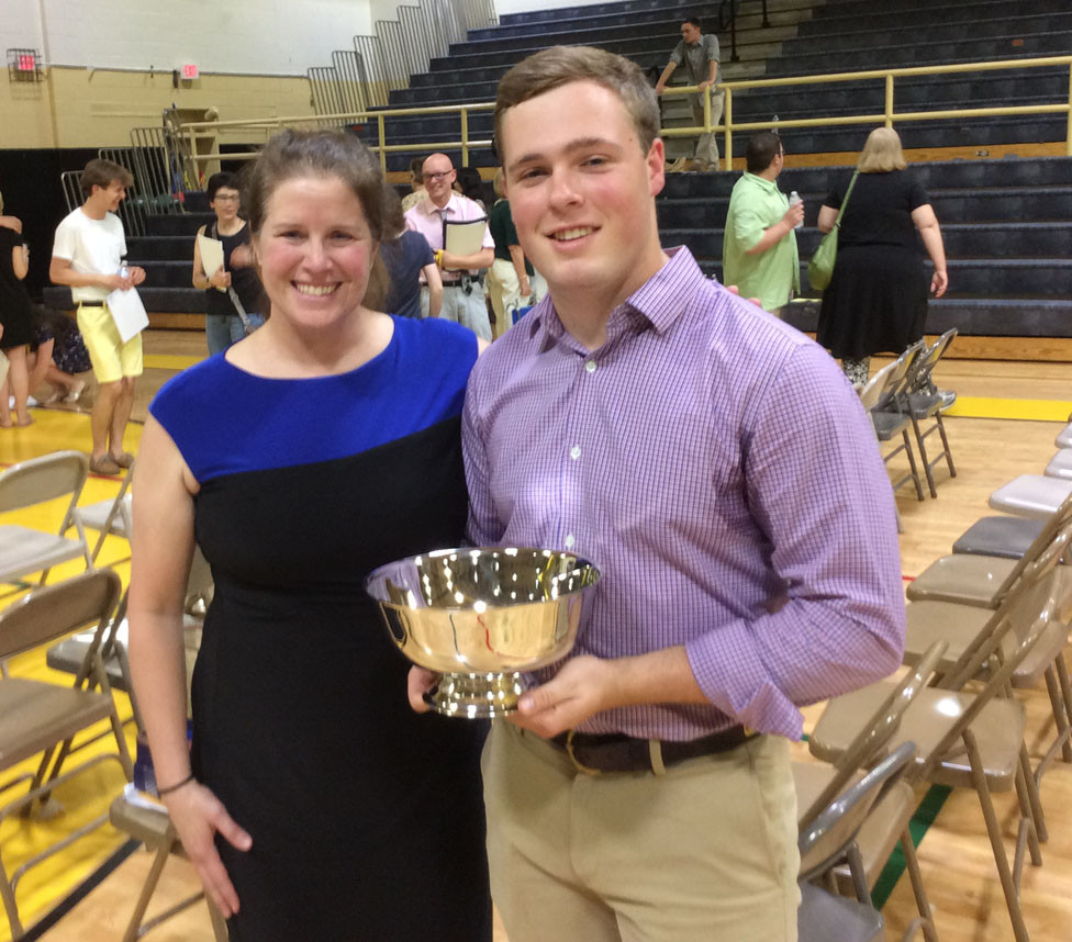 Brody McCoun, son of David & Sarah McCoun, received the Michael C. Wallace Award at the Woodford County High School Senior Class Night awards program on May 14.  Teacher Pam Duncan,  at left, presented the award. (Photo submitted)