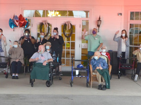 Drive-by parade honors veterans at Daisy Hill, Taylor Manor