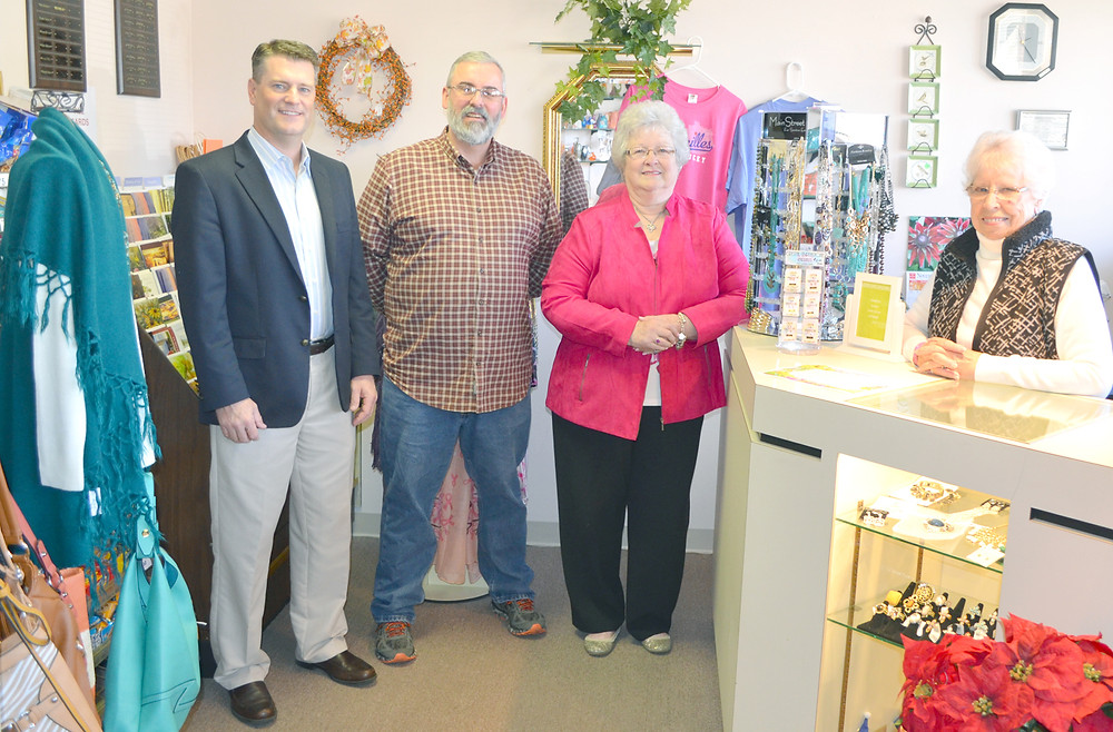 BLUEGRASS COMMUNITY HOSPITAL provides space for a gift shop operated by a dedicated group of volunteers. Profits from the sale of items help people in need. From left are hospital CEO Tommy Haggard, Tony Hardin, president of the Woodford County Ministerial Association, gift shop manager Phyllis Colburn and volunteer Dee Sidebotham. (Photo by Bob Vlach)