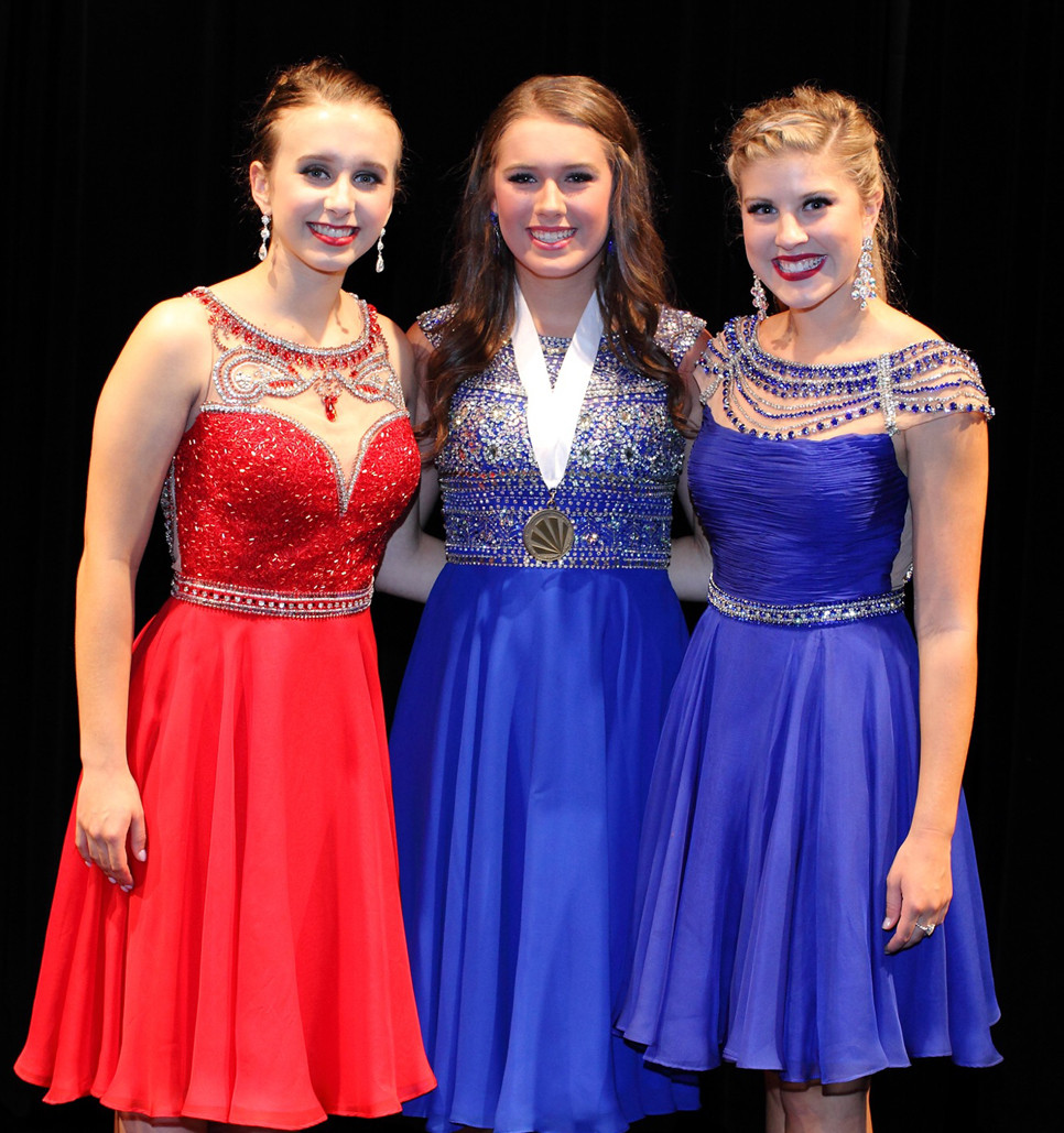 TURNER REYNOLDS, center, was named the Distinguished Young Woman of Woodford County on Saturday, Aug. 19. At left is Olivia Back, first runner-up, and at right is second runner-up Rebekah Hall.  (Photo by John Hemlepp)