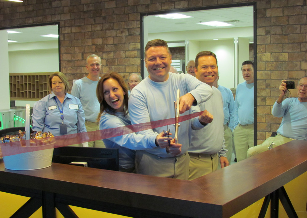 MORE THAN A BAKERY officials held a ribbon cutting Tuesday, Nov. 21 at the company's 250,000 square-foot plant off Big Sink Road. From left, holding the small scissors, Felicia Quigg; Bill Quigg and treasurer Rob Quigg. (Photo by John McGary)