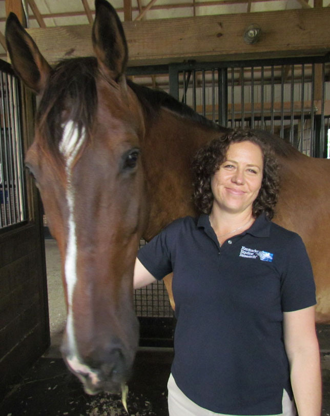 EILEEN PHETHEAN, the chief operating officer of Kentucky Equine Research, is pretty busy these days preparing for the 2018 World Equestrian Games in Tryon, N.C. However, she still finds time here and there to hang out with Marvin and the other research horses at their Delaney Ferry location. (Photo by John McGary)