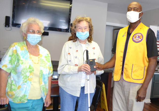 """A TALKING BIBLE from the Versailles Lions Club allows Juanita Carter to listen to the Old and New Testament of the Bible when she goes to sleep at night. """"And it's a comfort to me,"""" she said. From left are Marilyn McDaniel, Carter and Versailles Lions Club President Tim Smith. (Photo by Bob Vlach)"""