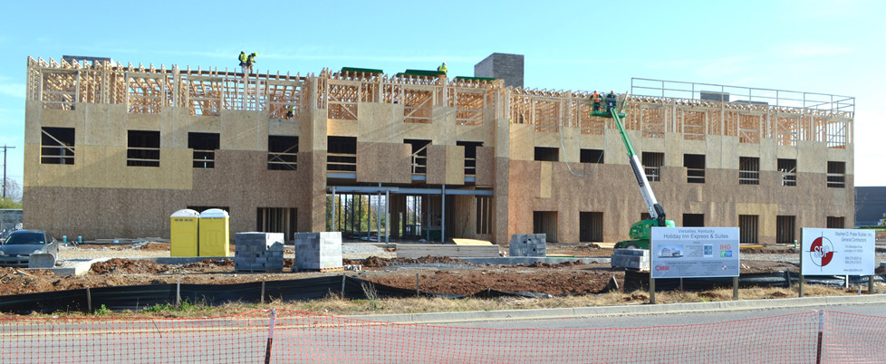 A HOLIDAY INN EXPRESS & Suites is scheduled to open its doors this summer. The 82-room hotel is located near the McDonald's restaurant and former location of the Versailles Center, where several businesses including Sweet Potatoes restaurant and a flea market once operated. (Photo by Bob Vlach)