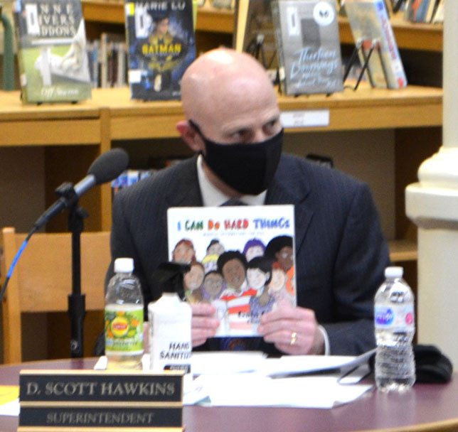 'I CAN DO HARD THINGS,' a book written by Gabi Garcia and illustrated by Charity Russell, is being given to all four elementary schools and both branches of the Woodford County Public Library in commemoration of School Board Recognition Month, schools Superintendent Scott Hawkins told board members Monday. (Photo by Bob Vlach)